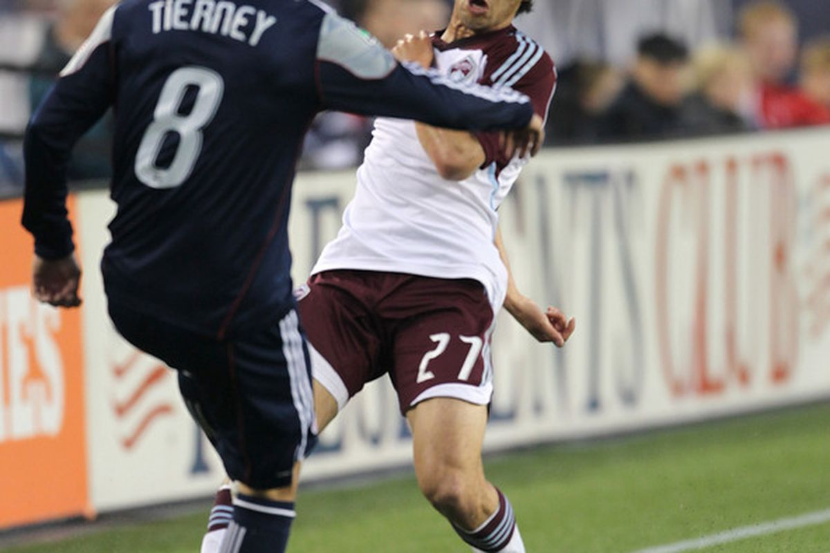 FOXBORO, MA - MAY 7: Kosuke Kimura #27 of Colorado Rapids battles Chris Tierney #8 of New England Revolution at Gillette Stadium on May 7, 2011 in Foxboro, Massachusetts. (Photo by Jim Rogash/Getty Images)