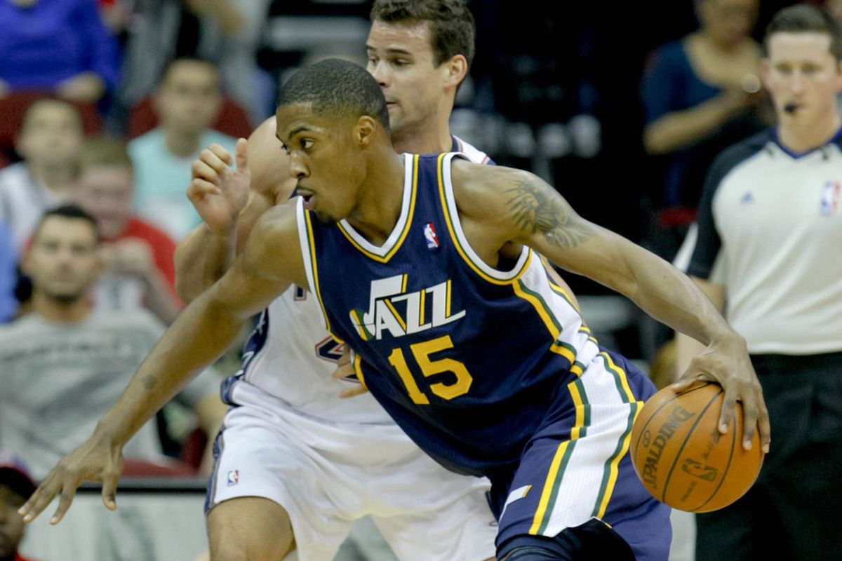 Mar 26, 2012; Newark, NJ, USA;  Utah Jazz forwardcenter Derrick Favors (15) controls the ball as New Jersey Nets power forward Kris Humphries (43) defends during the first half at the Prudential Center. Mandatory Credit: Jim O'Connor-US PRESSWIRE