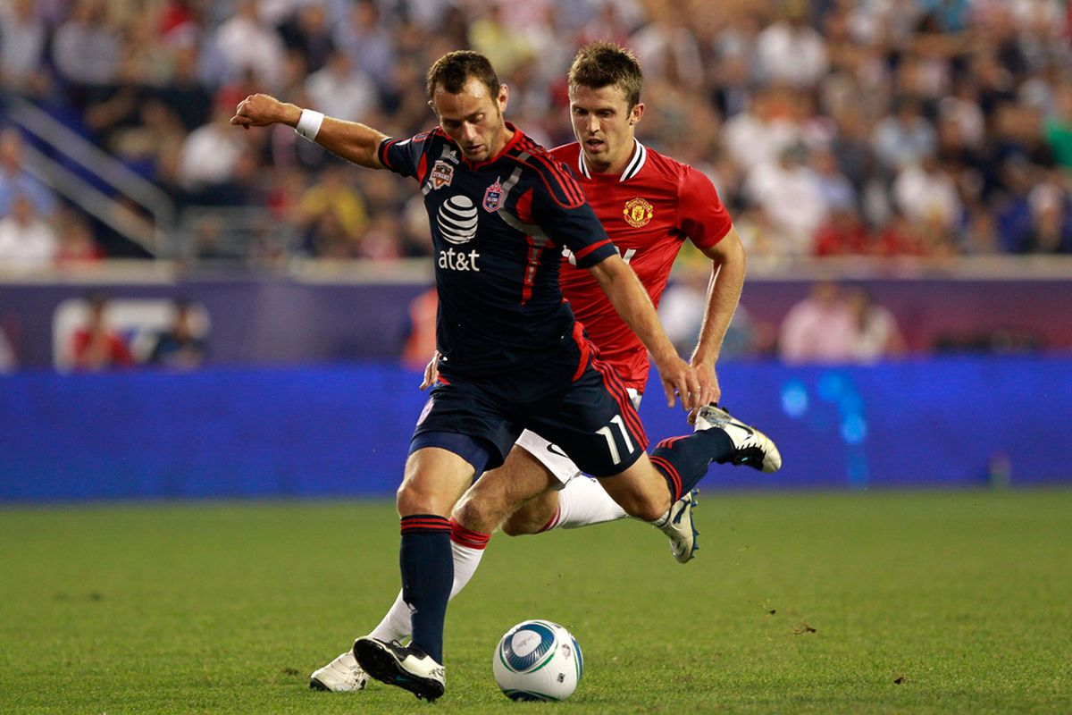 HARRISON, NJ - JULY 27:  Brad Davis #11 of the MLS All-Stars moves the ball against the Manchester United during the MLS All-Star Game at Red Bull Arena on July 27, 2011 in Harrison, New Jersey.  (Photo by Chris Trotman/Getty Images)