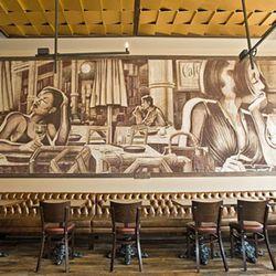 Artist Erni Vales hand-painted murals throughout the restaurant.