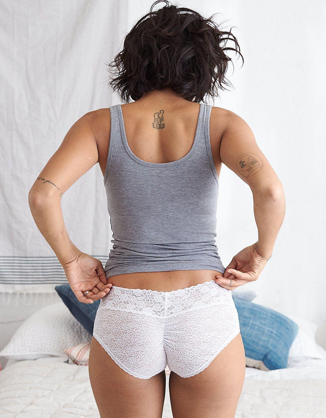 A model in lacy white underwear