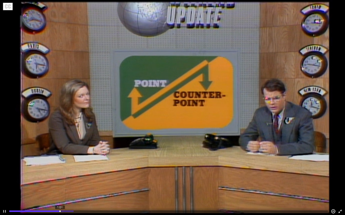 """Jane Curtin and Dan Aykroyd on the set of Saturday Night Live's """"Point / Counterpoint"""" sketch."""