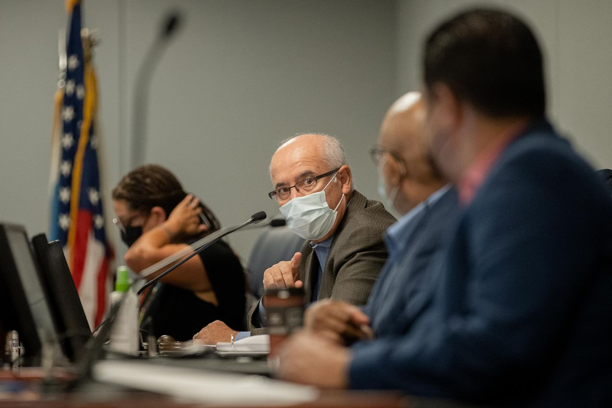 Chicago Board of Education President Miguel del Valle talks to members during a Chicago Board of Education meeting at the Chicago Public Schools headquarters in the Loop, in August.