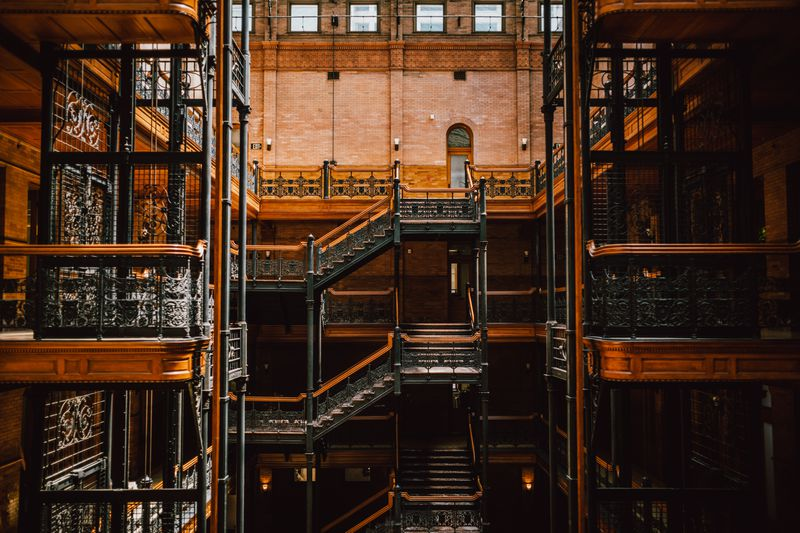 A photo of the ornate elevators and stairways inside the Bradbury Building.