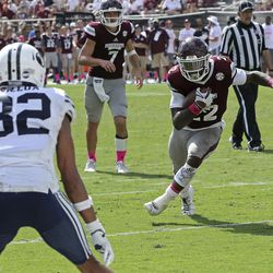Mississippi State running back Aeris Williams (22) finds running room into the end zone and pat BYU defensive back Chris Wilcox (32) during the second half of an NCAA college football game in Starkville, Miss., Saturday, Oct. 14, 2017. Mississippi State won 35-10.