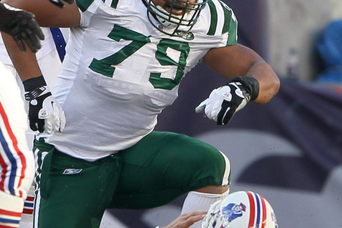 FOXBORO, MA - OCTOBER 09:   Ropati Pitoitua #79 of the New York Jets celebrates after he sacked  Tom Brady #12 of the New England Patriots on October 9, 2011 at Gillette Stadium in Foxboro, Massachusetts.  (Photo by Elsa/Getty Images)
