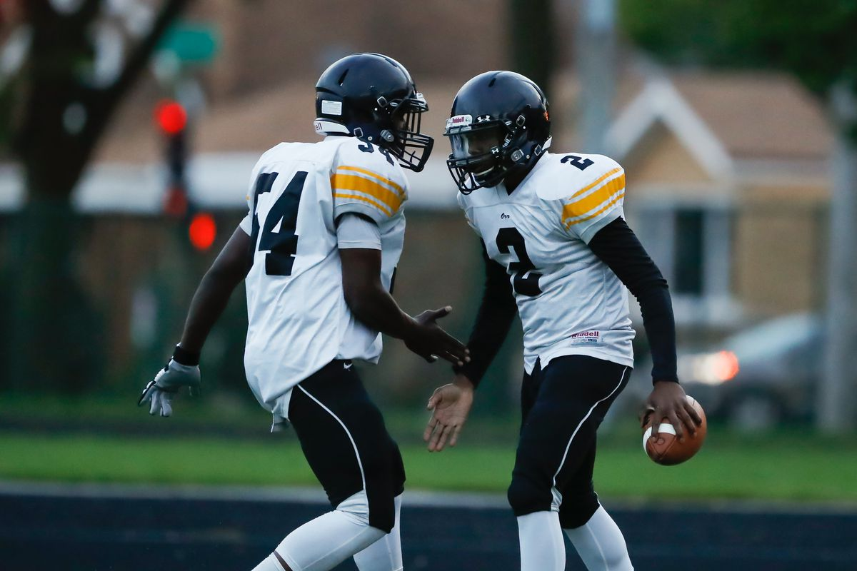 Orr's Kevon Crittle (2) and Omarion Paxton (54) celebrate Crittle's touchdown during the game against Hyde Park.