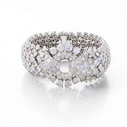 One-of-a-kind David Webb bracelet made of 203 round-cut diamonds, 52 rectangular-cut diamonds, and 54 marquise-cut diamonds. Circa 1968. $350,000
