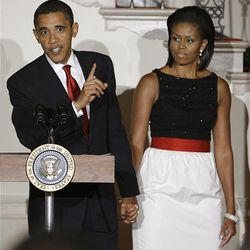 President Barack Obama, with his wife Michelle Obama, speaking during a reception for ambassadors in the Grand Foyer at The White House in Washington.