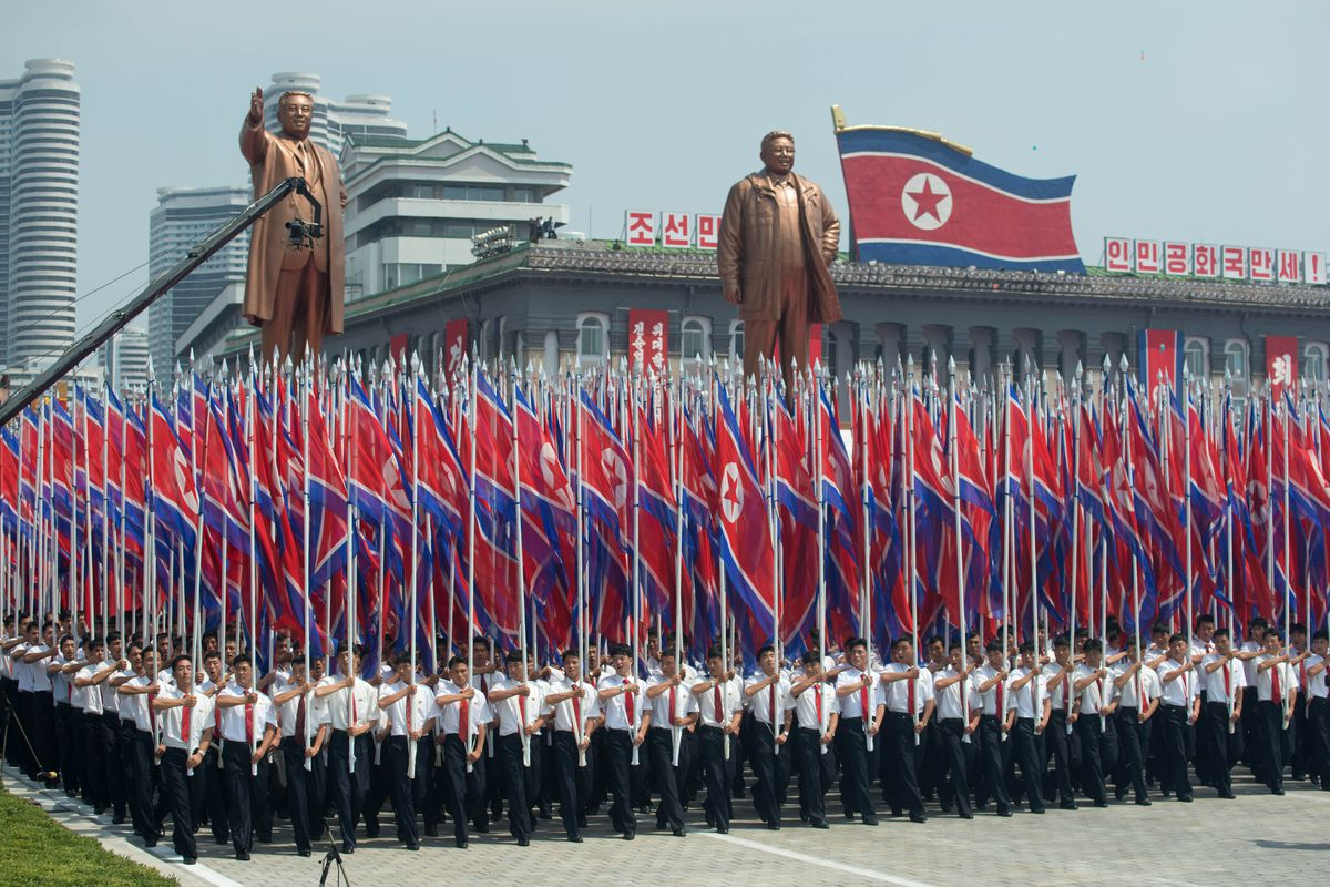 North Koreans march in a military parade in Pyongyang
