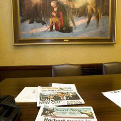 Newspapers reporting Gov. Herbert's inauguration Tuesday sit in the Lt. Governor's office Wednesday.