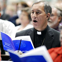 Bishop Duane Pederson of Rice Lake, WI joins more than 1,000 other voting members in a song during the Evangelical Lutheran Church of America assembly, Wednesday at the Minneapolis Convention Center.