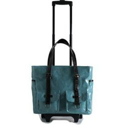 """Shiraleah's Vegan Harper Roller Tote Bag ($145, available at ShopBossa.com) is """"airline approved, and it fits in the overhead compartment and also under your seat,"""" says Rembos."""