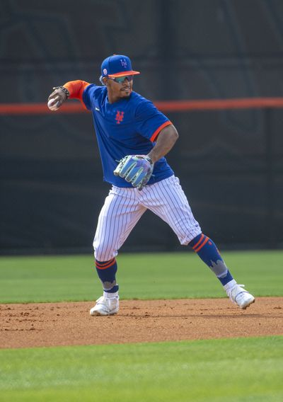 New York Mets shortstop Francisco Lindor takes infield practice during spring training workout