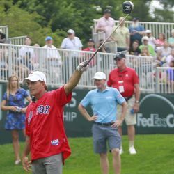 """Doug Flutie yells """"fore"""" left on the first hole."""