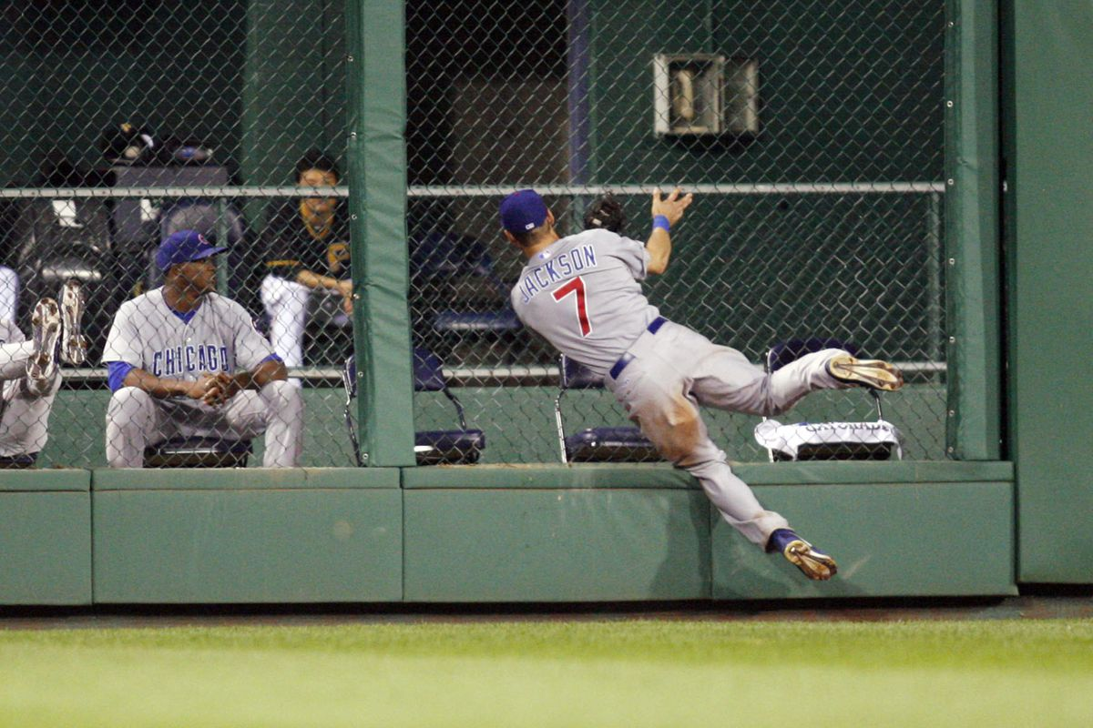 Pittsburgh, PA, USA; Chicago Cubs center fielder Brett Jackson crashes into the outfield fence making a leaping catch at the wall on a ball hit by Pittsburgh Pirates center fielder Andrew McCutchen at PNC Park. Credit: Charles LeClaire-US PRESSWIRE