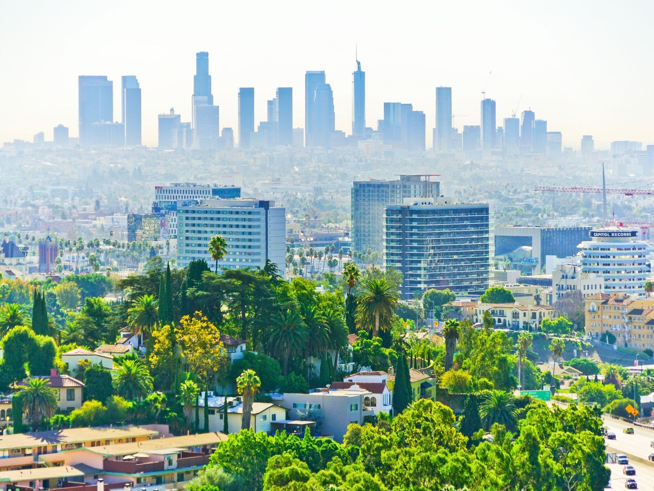 The growing Hollywood skyline in the foreground, with DTLA skyscrapers in the background.