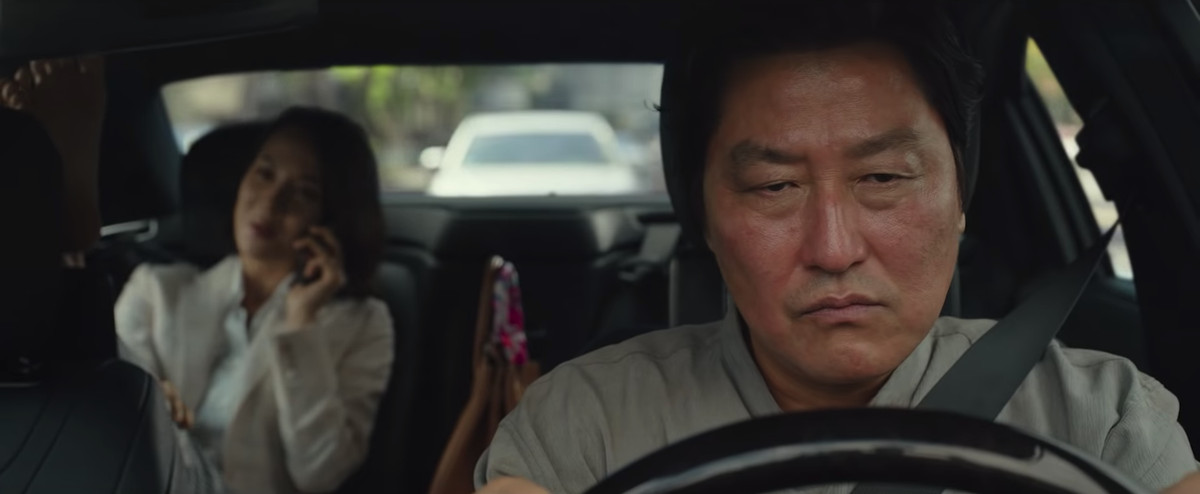 Mr. Kim (Song Kang-ho) drives a car but he's pissed in Parasite