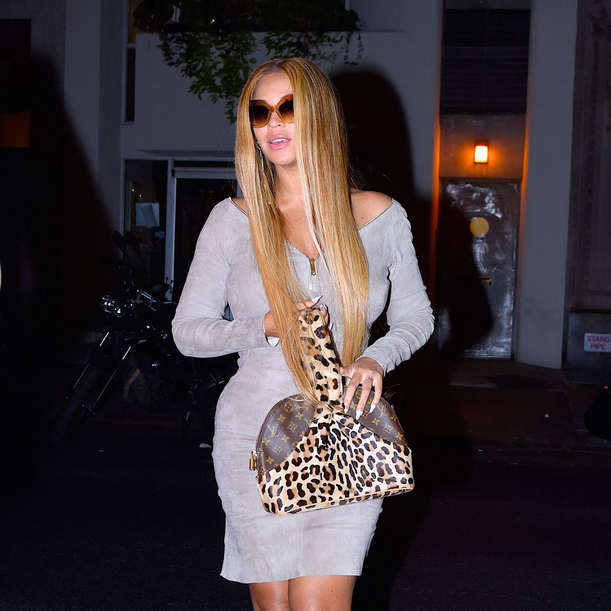 Beyonce carrying a leopard-print Louis Vuitton bag.