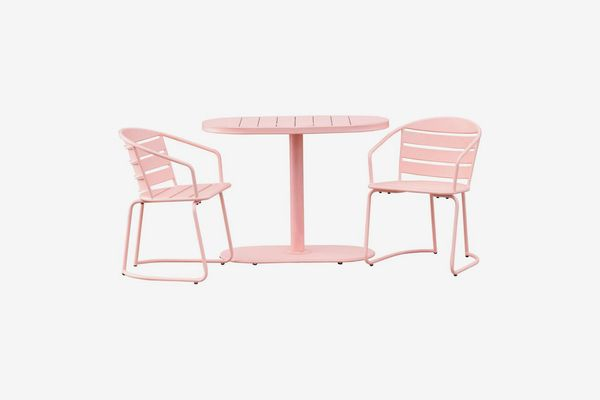 2 chairs and 1 bistro table in a pale pink color