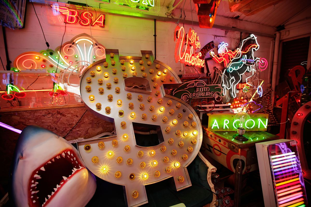 Workers Make And Renovate Neon Signs