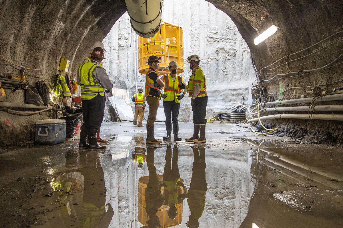 U.S. Secretary of Transportation Pete Buttigieg, center, receives a tour of an underground tunnel for the expansion of the Hartsfield–Jackson Atlanta International Airport plane train tunnel at the Hartsfield–Jackson Atlanta International Airport, Friday, May 21, 2021, in Atlanta.