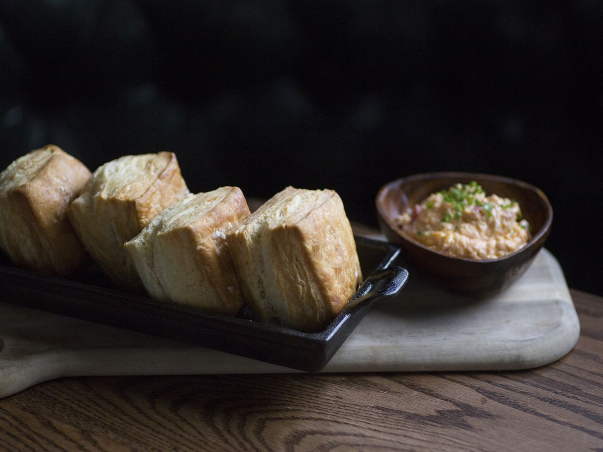 Square, layered biscuits from St. Anselm come with a side of pimento cheese