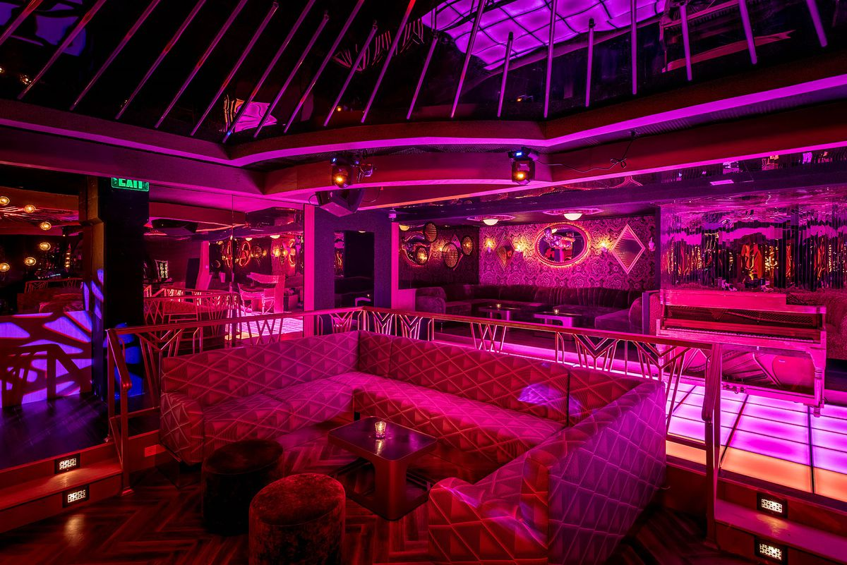 Purple lighting at Kiss Kiss Bang Bang's dance floor and lounge in Koreatown.
