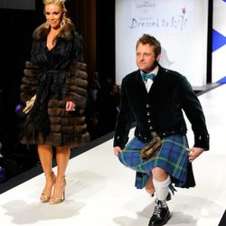 LX TV's George Oliphant walks the runway in his family tartan.