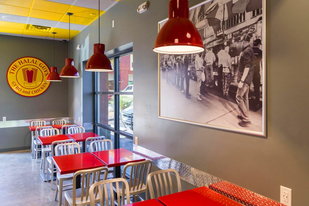 Casual restaurant interior with red tables