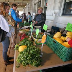Consumers shop for fresh vegetables and food at the Winter's Farmer Market at the Rio GrandeSaturday, March 14, 2015, in Salt Lake City.