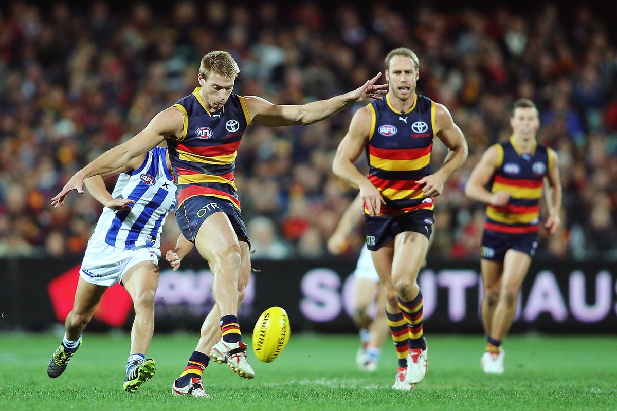 Daniel Talia of the Crows kicks the ball during the round 13 AFL match between the Adelaide Crows and the North Melbourne Kangaroos at Adelaide Oval on June 14, 2014 in Adelaide, Australia.