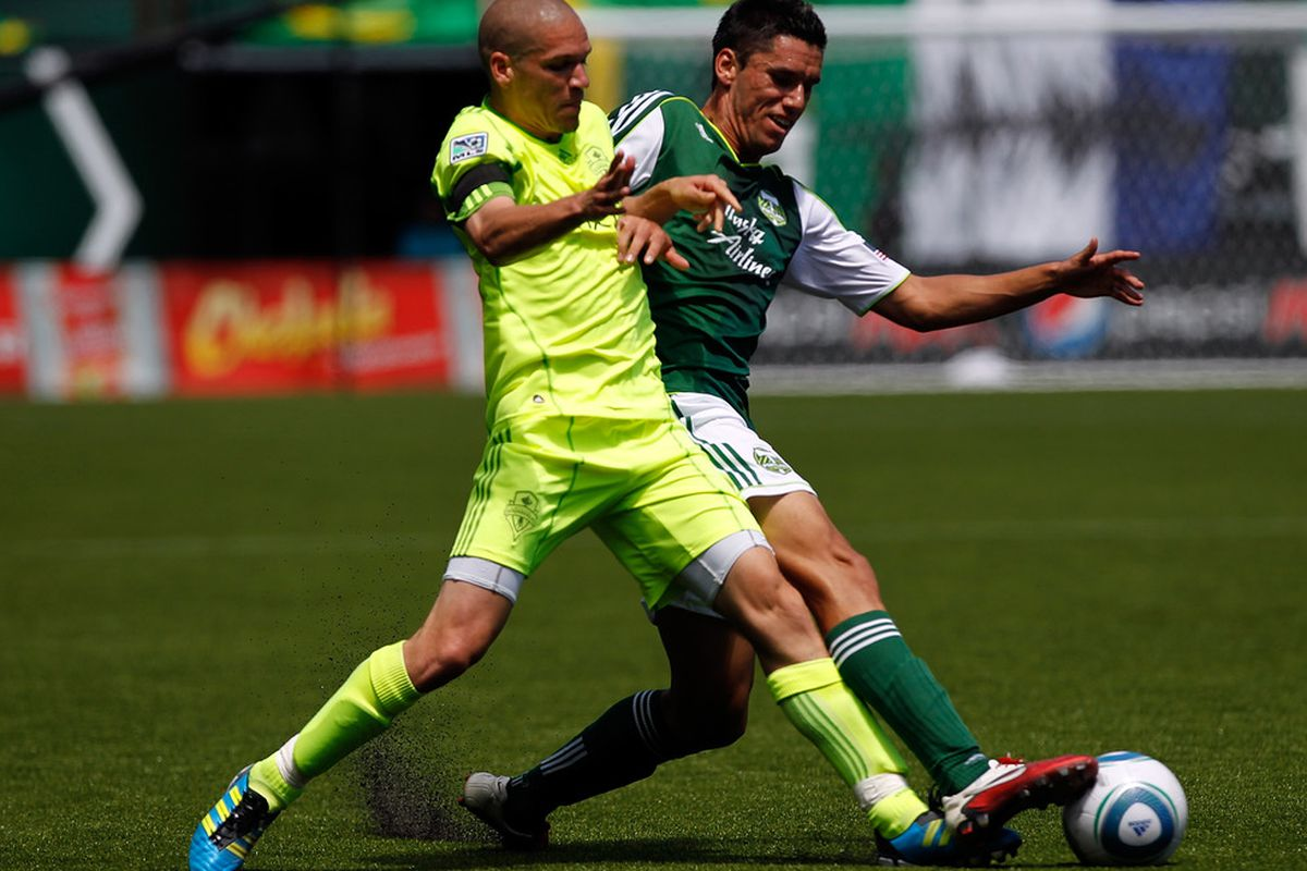 PORTLAND, OR - JULY 10: Osvaldo Alonso #6 of the Seattle Sounders battles Steve Purdy #25 of the Portland Timbers on July 10, 2011 at Jeld-Wen Field in Portland, Oregon. (Photo by Jonathan Ferrey/Getty Images)