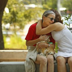 Alora Slemboski, right,  consoles Nancy Myers, outside the Red Cross Shelter, Monday, July 1 2013 in Prescott, Ariz. Myers fears she lost her home in the Yarnell Hill Fire. (AP Photo/The Arizona Republic, David Kadlubowski)