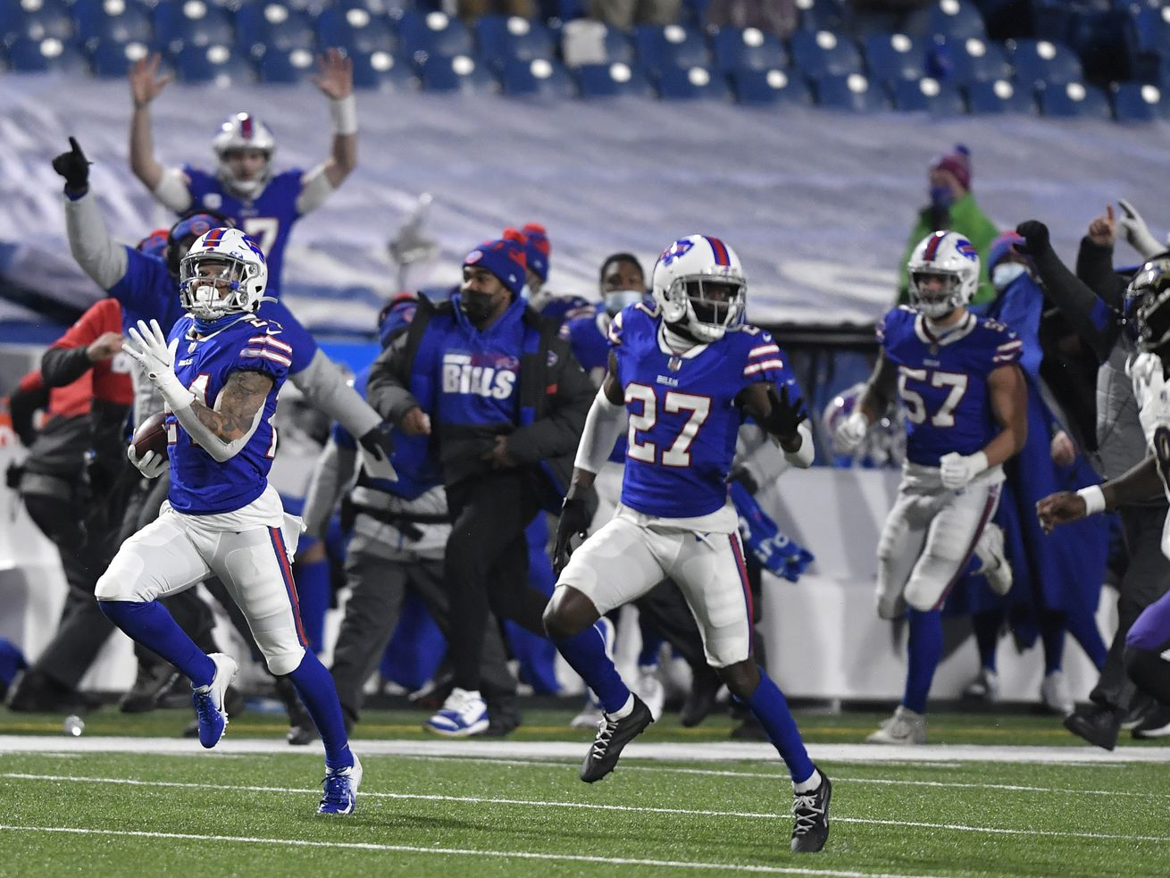 Weber State's Taron Johnson's pick-6 ties NFL playoff record; Utah's Tyler Huntley gets first postseason action