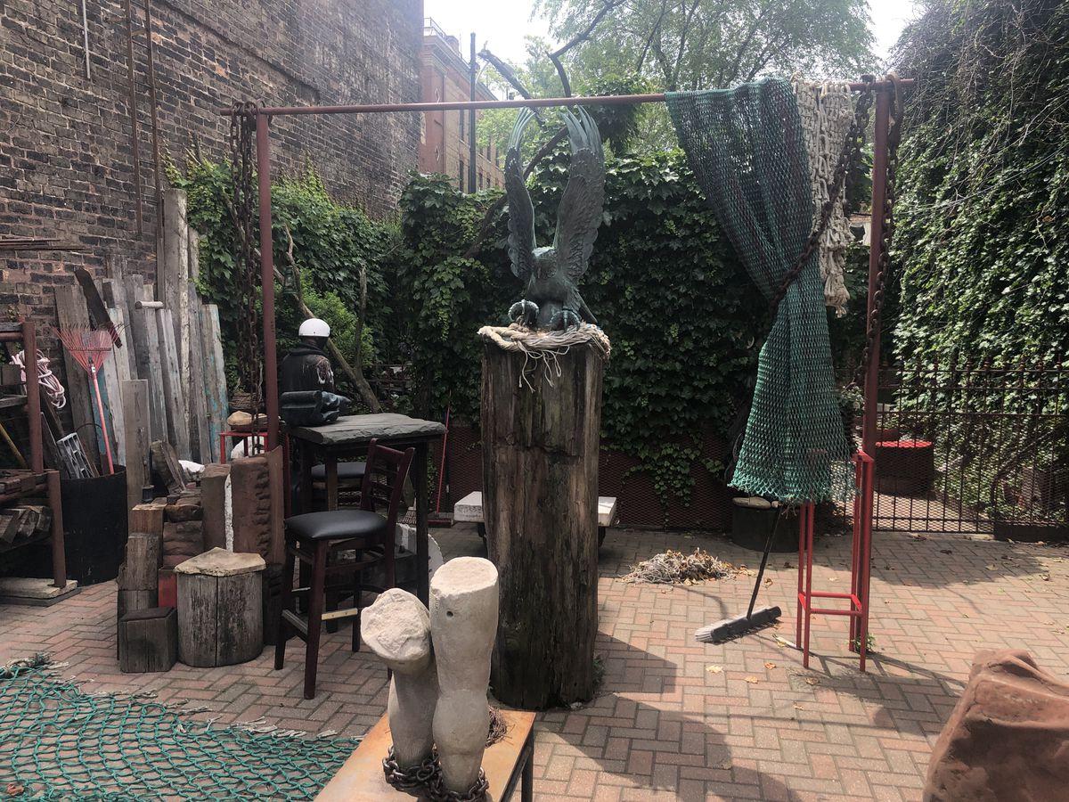 A garden area with art.