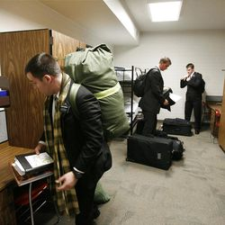 left to right: Elders Anthony Franklin, Samuel Miller, and John Scoggin pick up the last of their belongings before they leave the Provo Missionary Training Center of The Church of Jesus Christ of Latter-day Saints in Provo, Utah Tuesday, Feb. 15, 2011.