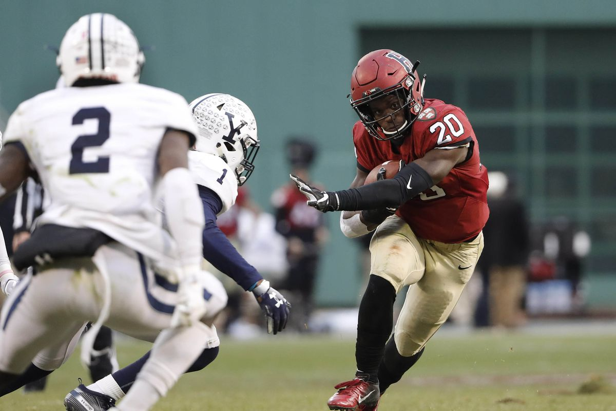 Harvard running back Aaron Shampklin runs against the Yale during the second half at Fenway Park.