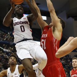 UConn's Antwoine Anderson (0) floats through the air as he goes to the basket.
