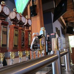 Partial view of the bar's tap line including Town Hall's iconic wooden clock tap handles.