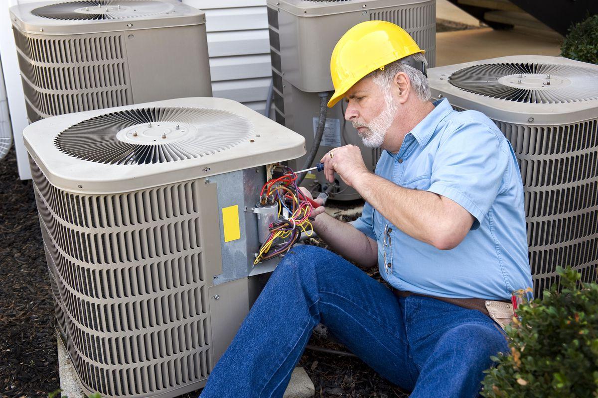 Man working on a HVAC unit