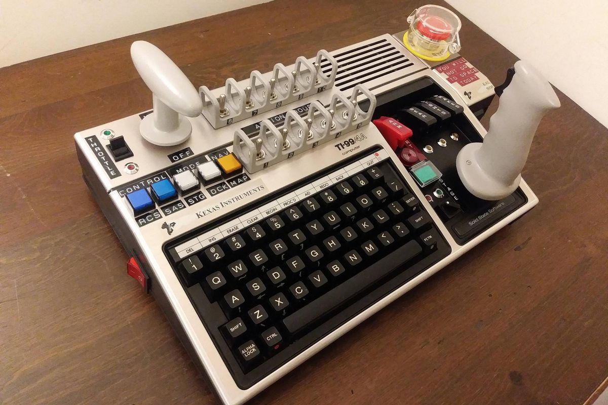 Picture of a very elaborate custom controller for the game Kerbal Space Program, looking like a vintage space program control panel.