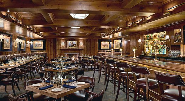 A swanky suburban wood-paneled bar.