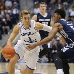 Brigham Young Cougars guard Chase Fischer (1) drives on Utah State Aggies guard Julion Pearre (5) as BYU and Utah State play at the Marriott Center in Provo Wednesday, Dec. 9, 2015.