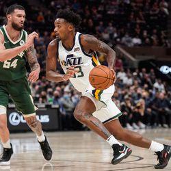 Utah Jazz forward Elijah Hughes (33) dribbles past Milwaukee Bucks forward Sandro Mamukelashvili during an NBA preseason game at Vivint Arena in Salt Lake City on Wednesday, Oct. 13, 2021.