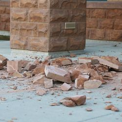 Debris from the entrance of Silver Crest Elementary School in Herriman is pictured after a after a 5.7 magnitude earthquake centered in Magna hit earlyon Wednesday, March 18, 2020.