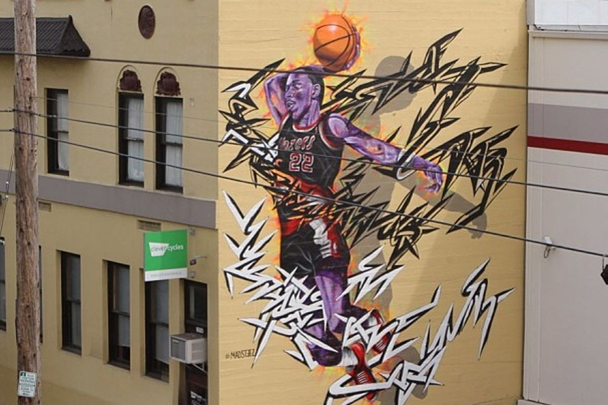 f625daa80963 Artists Paint Two-Story Mural Of Former Blazers G Clyde Drexler In ...