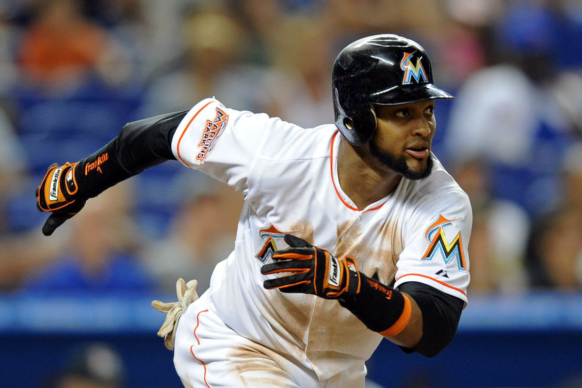 July 28, 2012; Miami, FL, USA; Miami Marlins center fielder Emilio Bonifacio (1) runs down the first baseline during a game against the San Diego Padres at Marlins Park. Mandatory Credit: Steve Mitchell-US PRESSWIRE