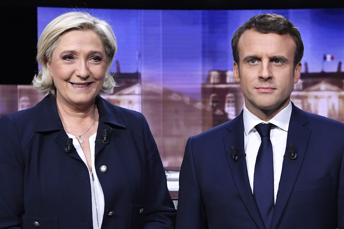 French presidential candidates Marine Le Pen and Emmanuel Macron pose before a debate this week.