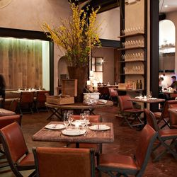 Cozy leather seats and light wood tables at to the Tuscan vibe